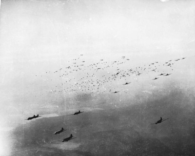 C-47 cargo planes release hundreds of paratroops during Operation Varisty